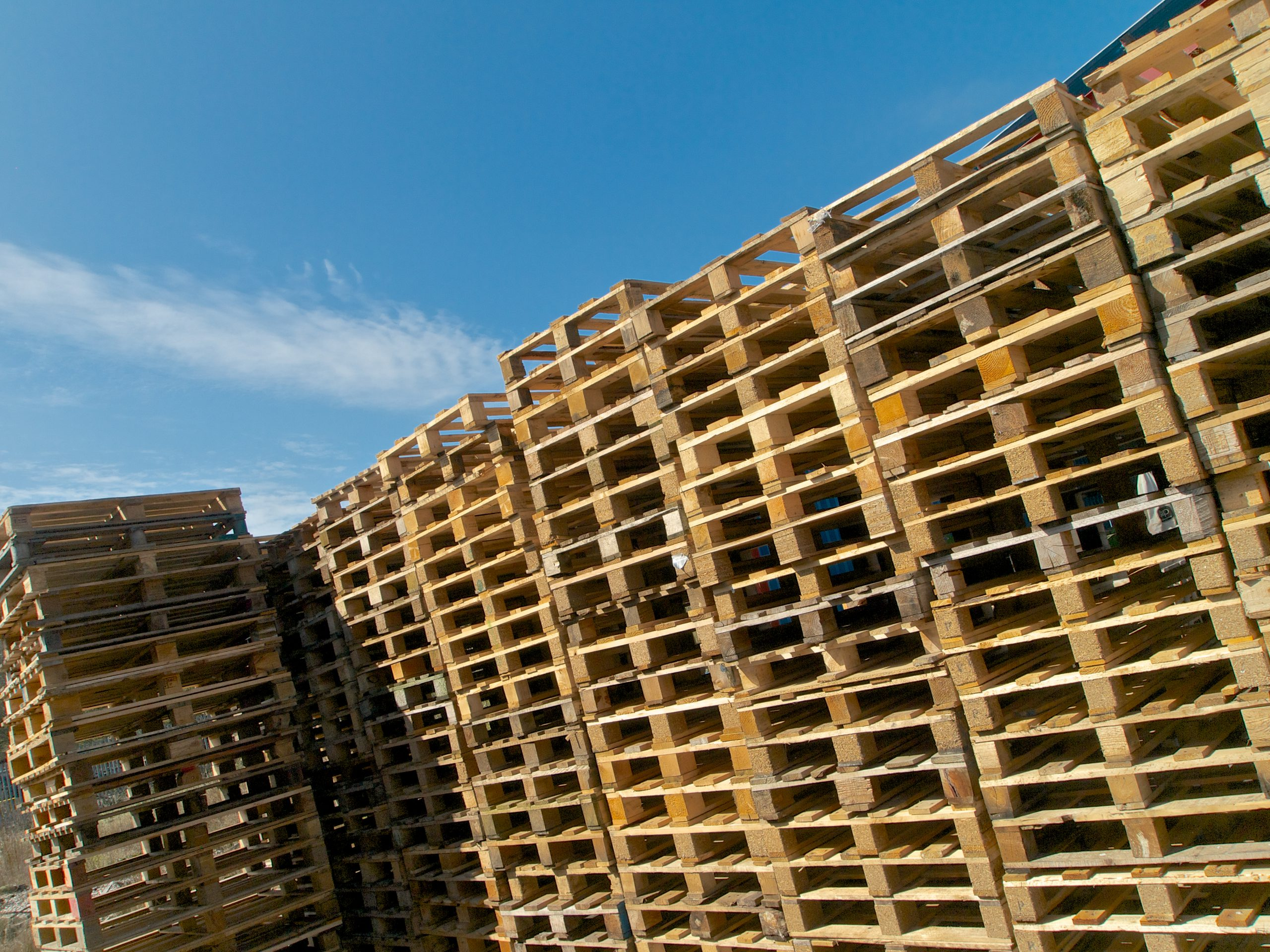 Stacks of used wooden pallets The Log People Shropshire