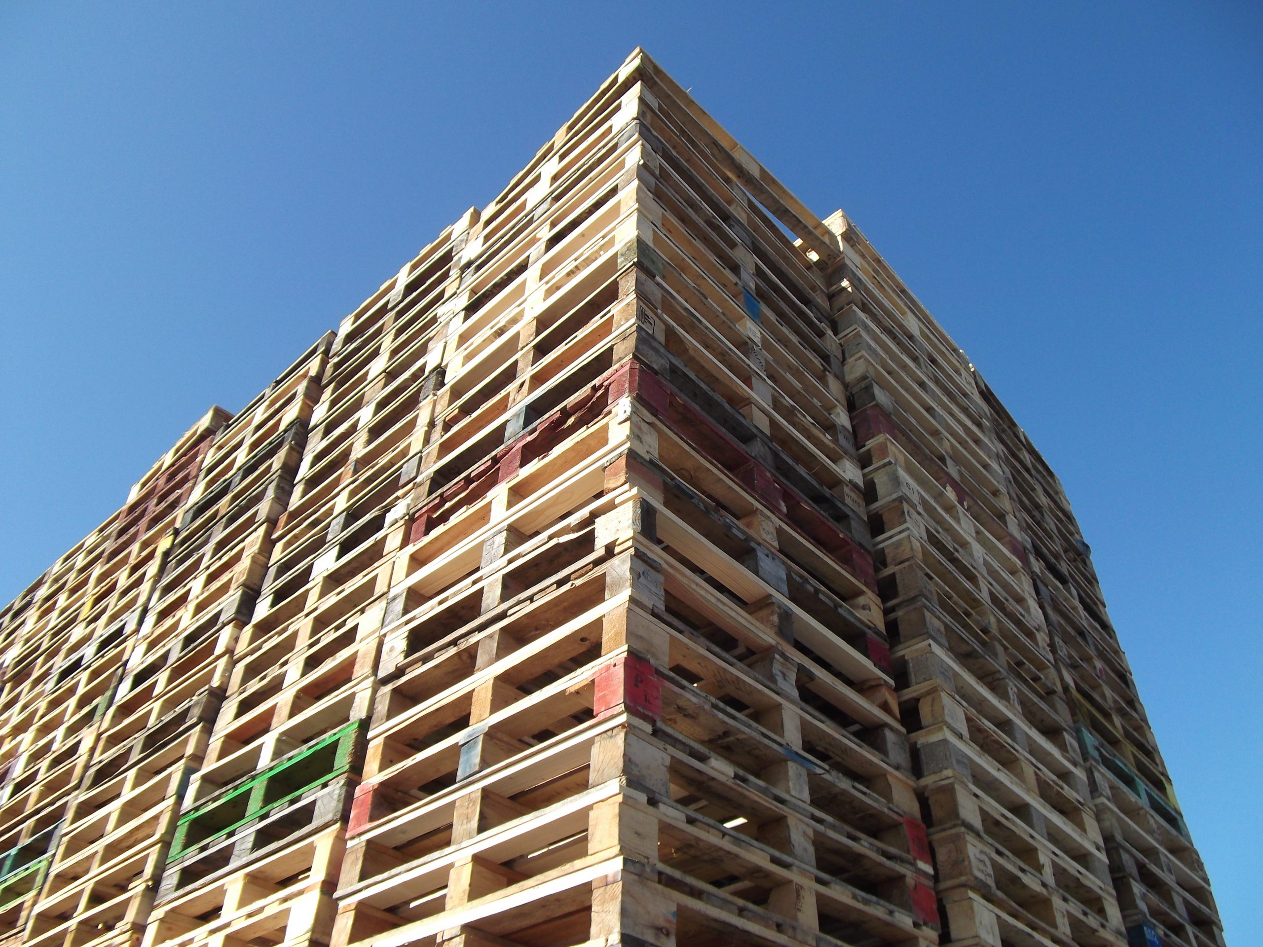Stacks of used wooden pallets from The Log People Shropshire