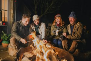 Family gathering around the fire